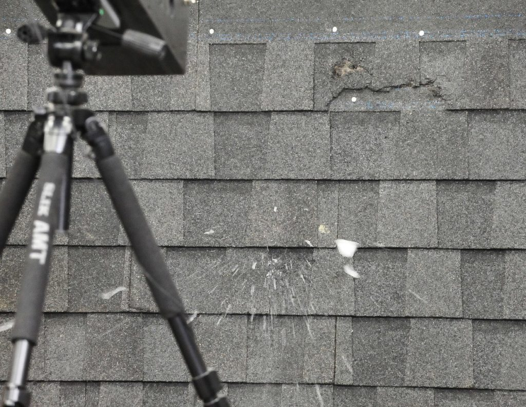 Inspecting hail damage to a roof